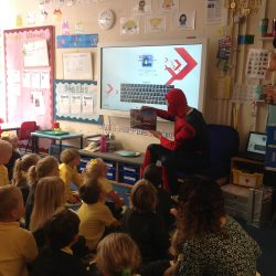 Spiderman reading us a story