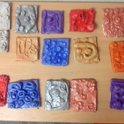 Year 2 made Medieval clay tiles during their Castle topic