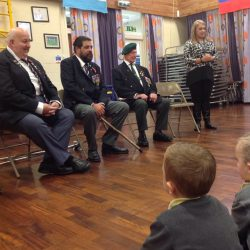Veterans visited the school to make poppies and talk to the children